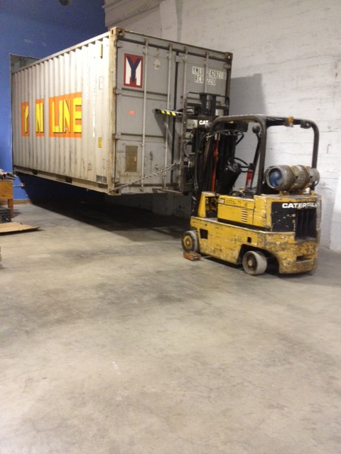 shipping container moving into the warehouse